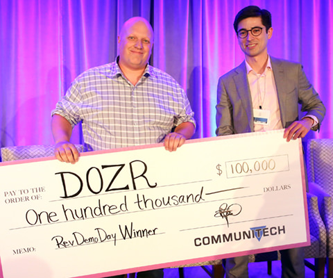 Kevin Forestell (left), co-founder of Dozr, an equipment sharing platform for the construction industry, took top honours at Rev Demo Day. (Photo: Tim Fraser for Communitech)